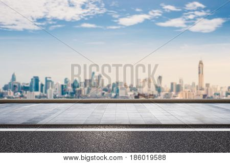 3d rendering roadside with cityscape and blue sky background
