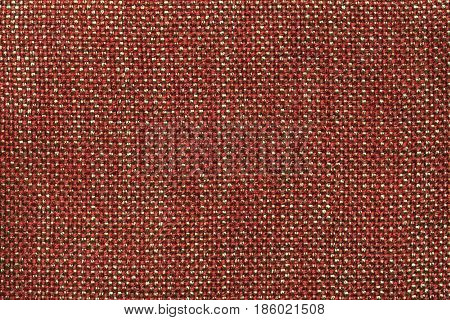 Dark orange background with checkered pattern closeup. Structure of the red fabric with natural texture. Cloth backdrop.
