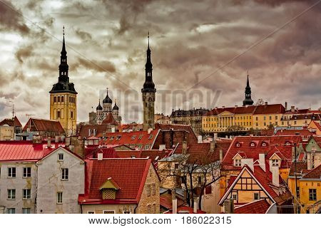 A view to the Tallinn old town from the wall surrounding the area. You can see the medieval church towers the orthodox cathedral and the house of the Government of Estonia.
