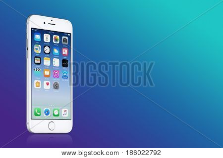 Varna, Bulgaria - March 10, 2016: Silver Apple iPhone 7 with iOS 10 on the screen on blue gradient background with copy space. Quick mockup for your design. High quality studio shot.