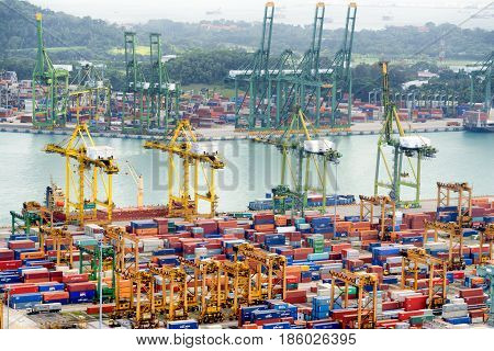 Gantry Cranes Loading And Unloading Ships, The Port Of Singapore