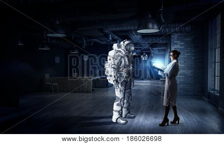 Scientists designing space suit. Mixed media