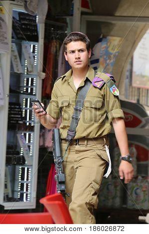 JERUSALEM, ISRAEL - APRIL 30, 2017: Israeli soldier at the Old City of Jerusalem.