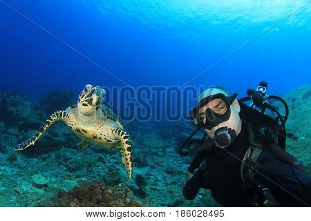 Scuba diver selfie with Sea Turtle