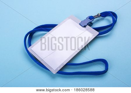 lanyard and badge blank space for text with blue ribbon. Blue or blue background