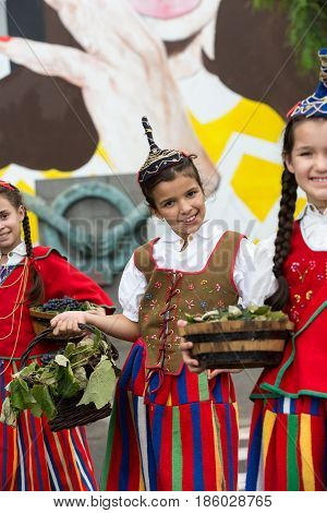 FUNCHAL PORTUGAL - SEPTEMBER 4 2016: Girls in traditional costume durnig historical and ethnographic parade of Madeira Wine Festival in Funchal. Madeira Portugal