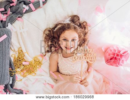 Beautiful little girl celebrating birthday party. Family celebration of the child
