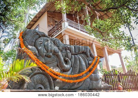 Sculpture of Sleeping Ganesha at Palolem, Goa, India.