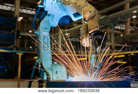Industrial welding robots are movement in production line