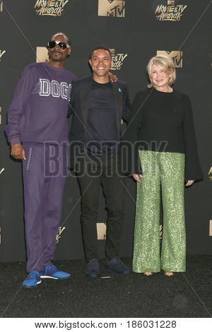 LOS ANGELES - MAY 7:  Snoop Dogg, Trevor Noah, Martha Stewart at the MTV Movie and Television Awards on the Shrine Auditorium on May 7, 2017 in Los Angeles, CA