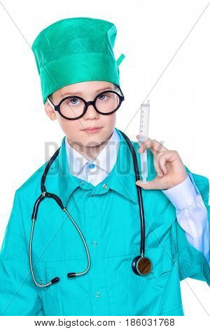 Cute smiling boy dressed like a doctor. Different occupations. Pediatrics. Isolated over white.