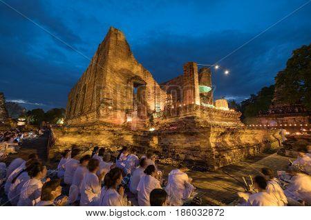 Ayutthaya - Thailand : 10 May 2017 - Buddhist Traditionally Lighting Of Candle, Circumambulation And