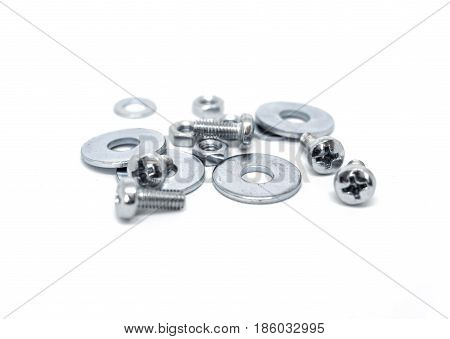 Skrews, nuts and washers isolated on the white