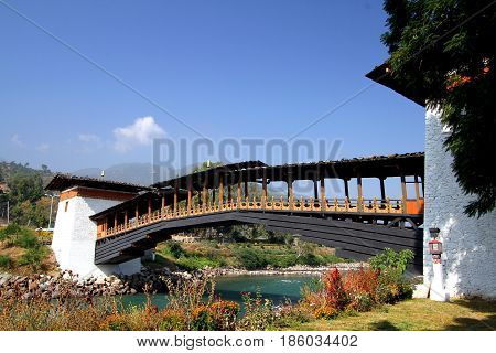 PUNA MOCCHU BAZAM : Antique wooden bridge at Punakha Dzong Monastery or Pungthang Dewachen Phodrang (Palace of Great Happiness) across the Mo Chhu river in Punakha the old capital of Bhutan.