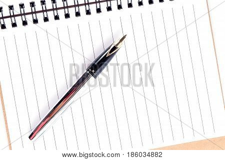 Opened notepad and pen education concept background