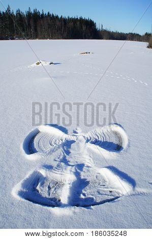 Snow Angel Made on Lake In Swedish Winterlandscape