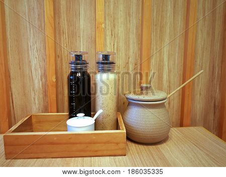 Bottles and jar of Japanese condiments on wooden background