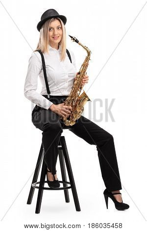 Female jazz musician with a saxophone sitting on a chair isolated on white background