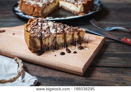 Homemade cheesecake - healthy organic summer dessert pie cheesecake. Cheese cake on wood table.
