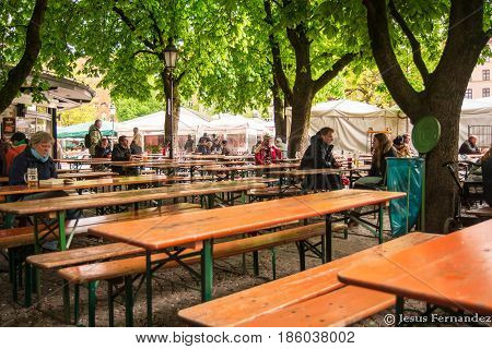 Munich,Germany-May 9,2017:People talk and drink beer at a beergarden near Marienplatz