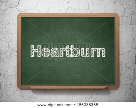 Medicine concept: text Heartburn on Green chalkboard on grunge wall background, 3D rendering