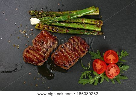 Two Grilled Beefsteak On Black Slate Board