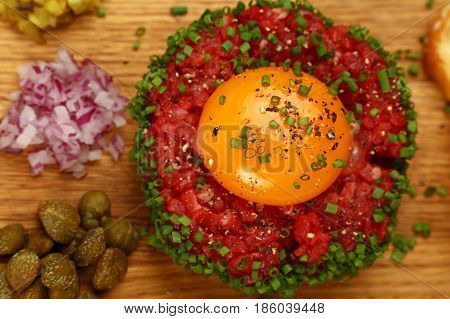 Raw Meat Tartare Steak With Egg Yolk Close Up