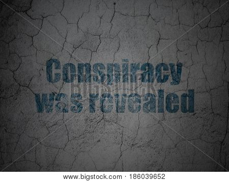Political concept: Blue Conspiracy Was Revealed on grunge textured concrete wall background