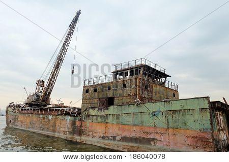 Wrecked abandoned ship on Chao Phraya river