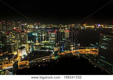 Aerial view over Tokyo cityscape, the Bay area with its bridges and Odaiba by night from Tokyo World Trade Center, Tokyo, Japan