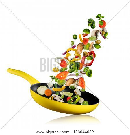 Fresh vegetables flying into a pan, isolated on white background. Concept of flying food, preparation, diet and healthy eating.