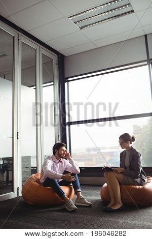 Unhappy man talking to counselor during therapy