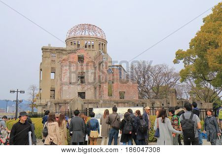 HIROSHIMA JAPAN - MARCH 20, 2017: Unidentified people visit Genbaku dome. Genbaku dome also know as Hiroshima Peace memorial is an UNESCO world heritage site.