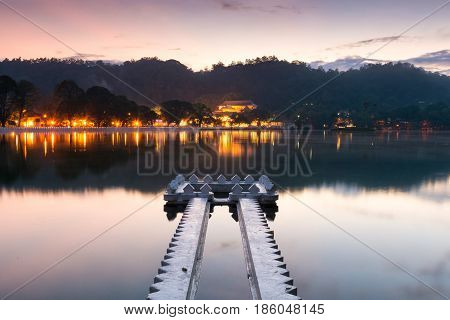 Kandy Lake and the Temple of the Sacred Tooth Relic (Sri Dalada Maligawa) at Sunrise, Kandy, Sri Lanka, Asia