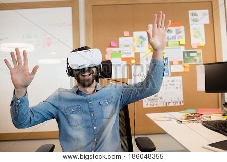 Businessman experiencing virtual reality in modern office