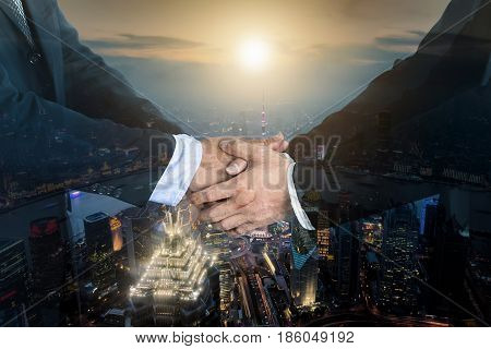 Deal or agreement business concept handshake double exposure cooperation or partnership business.