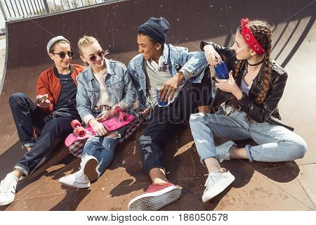 Teenagers Having Fun In Skateboard Park With Penny Board, Hipster Students Concept