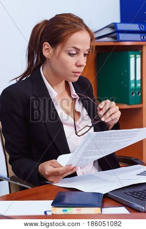 Business Concept: Attractive Woman Working With Papers In The Office