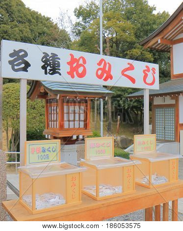 HIROSHIMA JAPAN - MARCH 20, 2017: Lucky fortune paper Omikuji at Hiroshima Gokoku shrine. Omikuji is random fortunes written on strips of paper at Shinto shrines and temples in Japan.