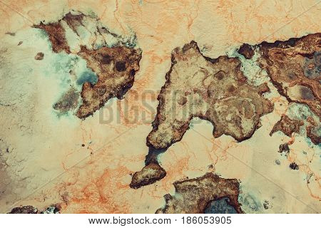 Toxic dirty water and red ground. Abstract bad ecology concept.