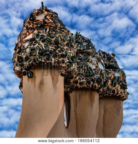 Barcelona, Spain - May 7, 2017: Casa Mila (La Pedrera) terrace building with chimneys