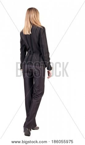 walking businesswoman. back view. going young girl in  suit. Rear view people collection.  back side view of person.  Isolated over white background.