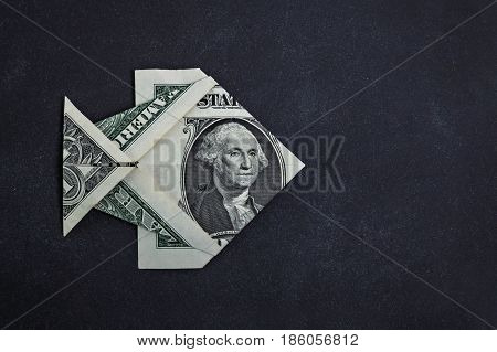 Origami dollar fish money symbol business on a black background