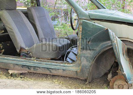 broken-down old car standing in the yard.