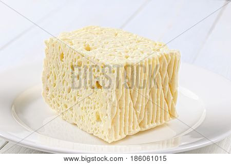 Piece Of Feta Cheese On White Plate