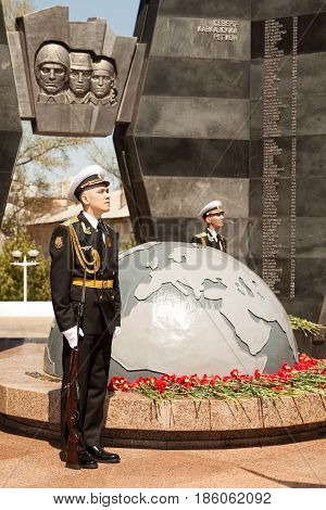 Khabarovsk Russia - May 9 2017: Guard of honor at the Great Patriotic War memorial on May 9 Victory Day. USSR historic event commemoration at globe Earth monument