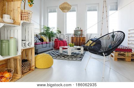 Living room with round chair yellow pouf sofa pallet furniture
