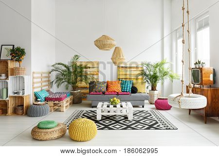 Creative relaxing space with retro tv rattan lamp and swing