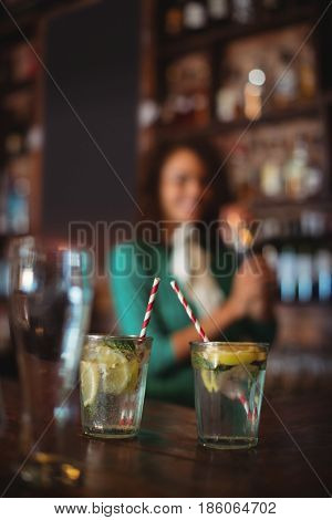 Two glasses of cocktail on worktop at bar counter