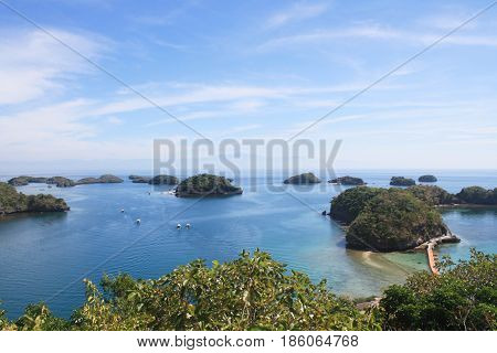 Group of islets (small islands) in blue waters with clear blue sky and beautiful trees